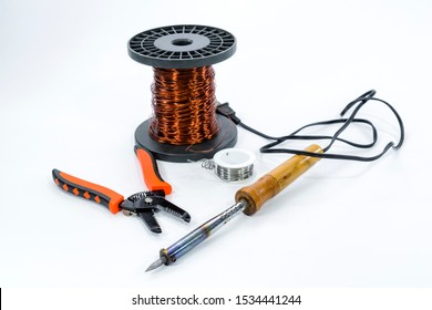 Soldering iron solder wire copper wire on roll and cable cutters on white background is craftsman tool electronic