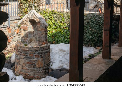 Soldeu / Andorra - February  2020: A porch of the Church of Saint Bartomeu in Soldeu.  Urban landscape of the city of Soldeu in the winter.