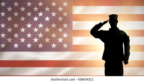 Soldier against digitally generated american national flag