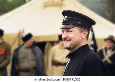 Soldier anarchist in black uniform, reenactment of Russian civil war