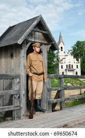The soldier armed with a gun standing at sentry. Costume accord the times of World War I. Photo made at cinema city Cinevilla in Latvia.