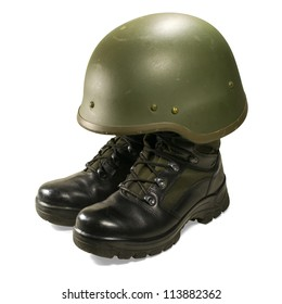 Soldier and army attributes: military boots and helmet. Isolated on white background. Clipping path (without shadow).
