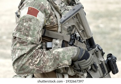 Soldier with assault rifle and flag of China on military uniform. Collage.