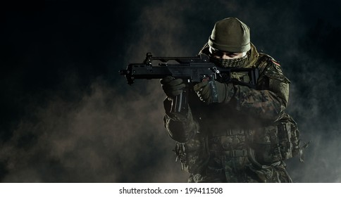 Soldier in an attack/defensive position. Going up in smoke. Destroyed object.