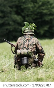 Soldier in battle during historical reenactment of World War II partisan battle in Slovak mountains