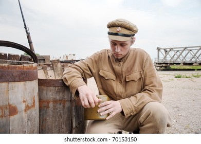 Soldier with a boiler in uniform of World War I. Costume accord the times of World War I. Photo made at cinema city Cinevilla in Latvia. Cockade on the hat do not contain trade mark.