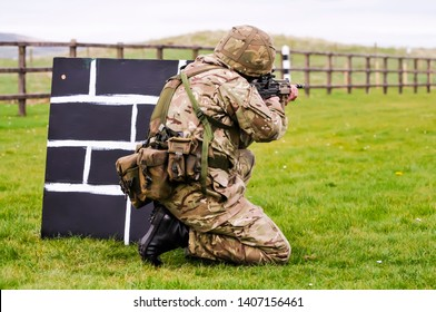 A soldier from the British Army trains on a military firing range with an assault rifle