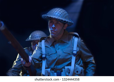 A soldier in the British Infantry marches into battle during a World War Two stage drama.