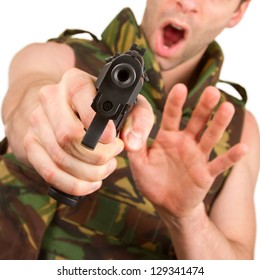 Soldier in camouflage vest is holding a gun, isolated