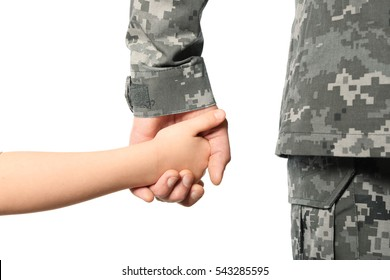 Soldier and child holding hands on white background, closeup