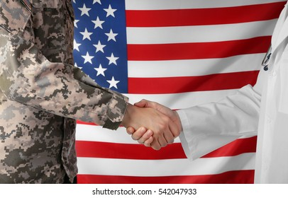 Soldier and doctor shaking hands on American flag background