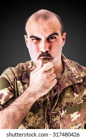 a soldier or drill sergeant blowing a whistle over a dark backdrop