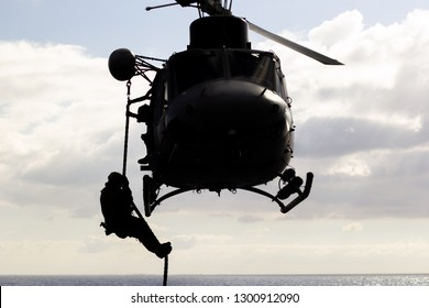 A soldier during a jump from a helicopter in the navy. Navy special forces