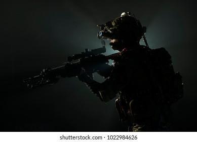 Soldier of the elite special purpose unit surveillance holding gun machine