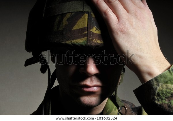 Soldier With Face In Shadow