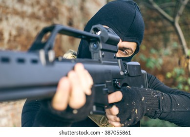 Soldier fighting on the enemy land. concept about warfare and terrorism. Soft air player shooting with his rifle