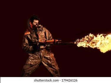 Soldier with flamethrower on dark background
