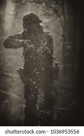 A soldier in the forest. Water splashes. Goes to the attack. Airsoft team. Attack on the enemy. For life or death. Ready to fight to the last. Goes by the water. Ready to shoot for defeat. Deep wood h