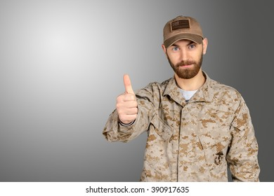 Soldier gesturing thumbs up