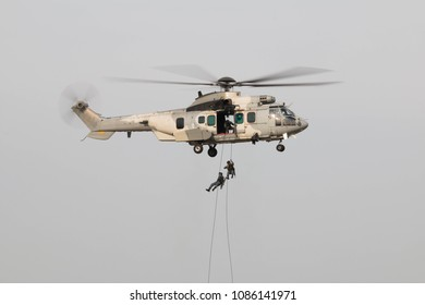 soldier go down using rope from helicopter.