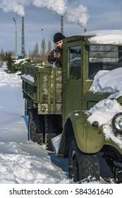 soldier with a gun and machine gun in winter