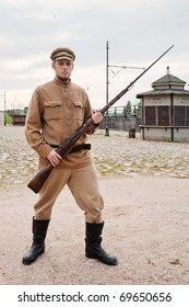 Soldier with a gun in uniform of World War I. Costume accord the times of World War I. Photo made at cinema city Cinevilla in Latvia.