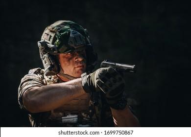 Soldier holding a gun. soldier concept