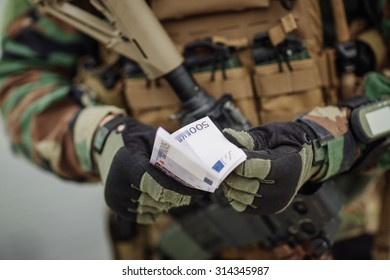 Soldier Holding Out Cash