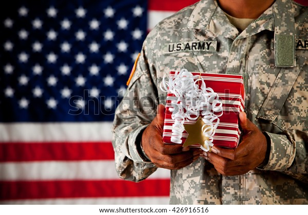 Soldier: Holding a Wrapped Gift