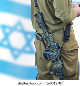 Soldier of Israeli defense forces on the Israeli flag bokeh background. Close up