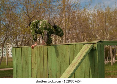 soldier jumps over an obstacle.