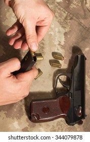 Soldier load ammo in the clip Makarov pistol. Clouse up