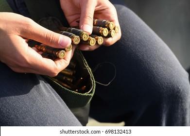 soldier loads ammunition links for training
