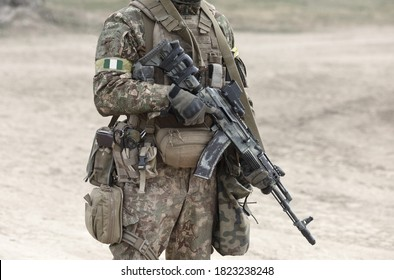 Soldier with machine gun and flag of Nigeria on military uniform. Collage.