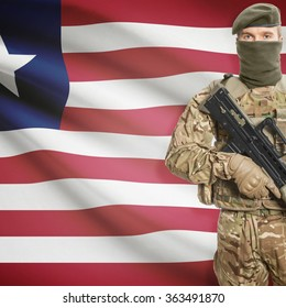 Soldier with machine gun and national flag on background series - Liberia