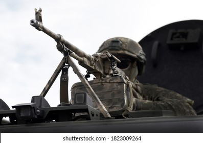 Soldier with a machine gun. War in Africa. Military conflicts in Africa