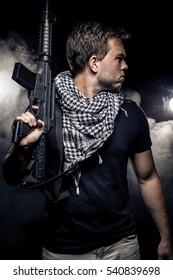 Soldier or mercenary wearing a shemagh with assault rifle, paintball or airsoft gun.  The image also depicts militarization of police or PMC private military companies