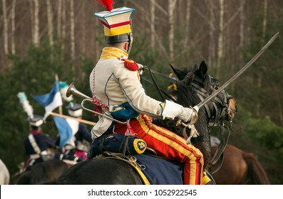 A soldier of the Napoleonic army on a horse with a sword.