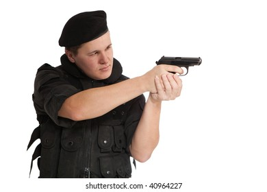 Soldier in NATO uniform with the Makarov pistol. Isolated on white.