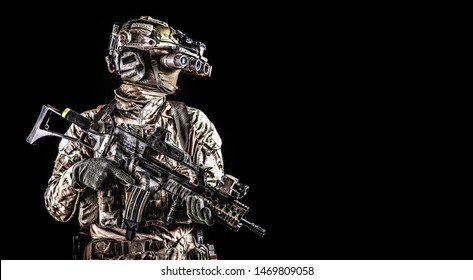 Soldier in night vision device on black background