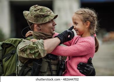 Soldier On Leave Hugging Daughter