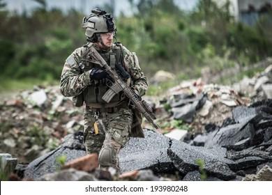 soldier on patrol at modern battle field