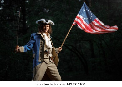 Soldier patriot rebel during war of independence of  United States with flag preparing to attack with sword