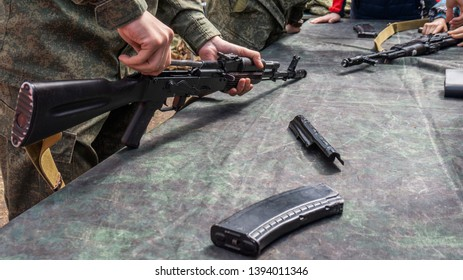 The soldier performs disassembly automatic rifle Kalashnikov