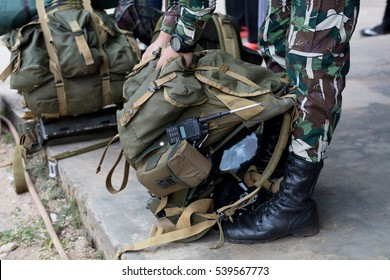Soldier prepare knapsack before walk in the forest / Military backpack