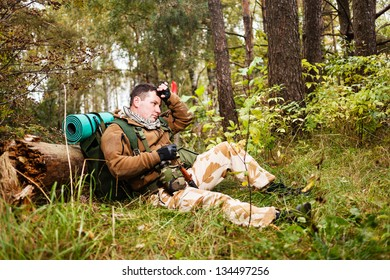 Soldier relaxing in a forest.