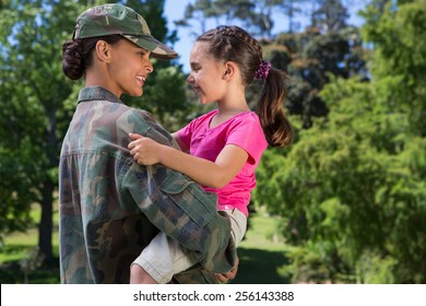 Soldier reunited with her daughter on a sunny day