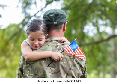 Soldier reunited with his daughter on a sunny day