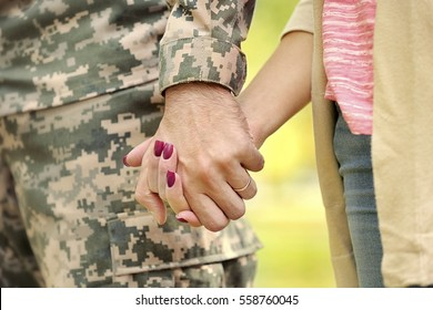 Soldier reunited with wife, closeup