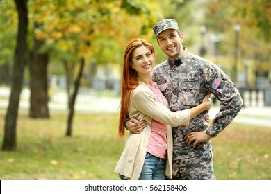 Soldier reunited with wife in park